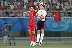 10 August 2008: Jan Vertonghen (BEL) (right) wins a header over Zheng Zhi (CHN) (left).  The men's Olympic soccer team of Belgium defeated the men's Olympic soccer team of China 2-0 at Shenyang Olympic Sports Center Wulihe Stadium in Shenyang, China in a Group C round-robin match in the Men's Olympic Football competition.