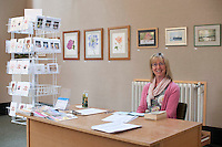 Students take turns manning the gallery for an exhibition of their work from the watercolour course, Harvey Gallery, Adult Learning Centre, Guildford, Surrey.