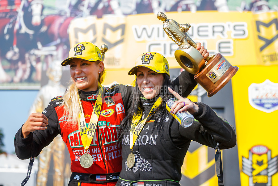 Aug 20, 2017; Brainerd, MN, USA; NHRA top fuel driver Leah Pritchett (left) and funny car driver Alexis DeJoria celebrate after becoming the first women to sweet nitro classes during the Lucas Oil Nationals at Brainerd International Raceway. Mandatory Credit: Mark J. Rebilas-USA TODAY Sports
