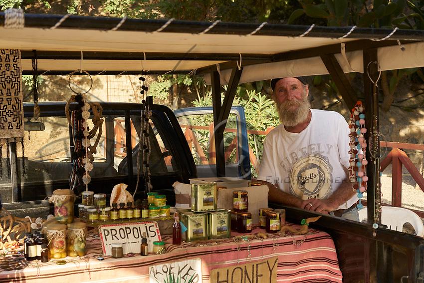 Cretan beekeeper near Preveli. The sale of honey to tourists is a source of income for the local beekeepers.<br /> Apiculteur Cr&eacute;tois pr&egrave;s de Preveli. La vente du miel aux touristes est une source de revenue pour les apiculteurs locaux.