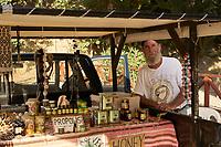 Cretan beekeeper near Preveli. The sale of honey to tourists is a source of income for the local beekeepers.<br /> Apiculteur Crétois près de Preveli. La vente du miel aux touristes est une source de revenue pour les apiculteurs locaux.
