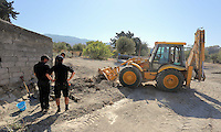 Pictured: Special forensics police officers make use of a digger to search a part of a field near a disused building in Kos, Greece. Saturday 01 October 2016<br /> Re: Police teams led by South Yorkshire Police, searching for missing toddler Ben Needham on the Greek island of Kos have moved to a new area in the field they are searching.<br /> Ben, from Sheffield, was 21 months old when he disappeared on 24 July 1991 during a family holiday.<br /> Digging has begun at a new site after a fresh line of inquiry suggested he could have been crushed by a digger.