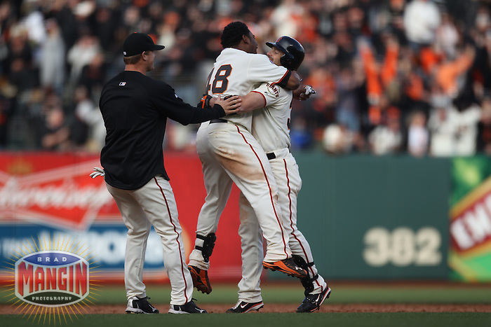 SAN FRANCISCO - APRIL 8:  Matt Cain, Pablo Sandoval, and Aaron Rowand of the San Francisco Giants celebrate after Rowand knocked in the winning run in the bottom of the 12th inning against the St. Louis Cardinals during Opening Day at AT&T Park on April 8, 2011 in San Francisco, California. Photo by Brad Mangin