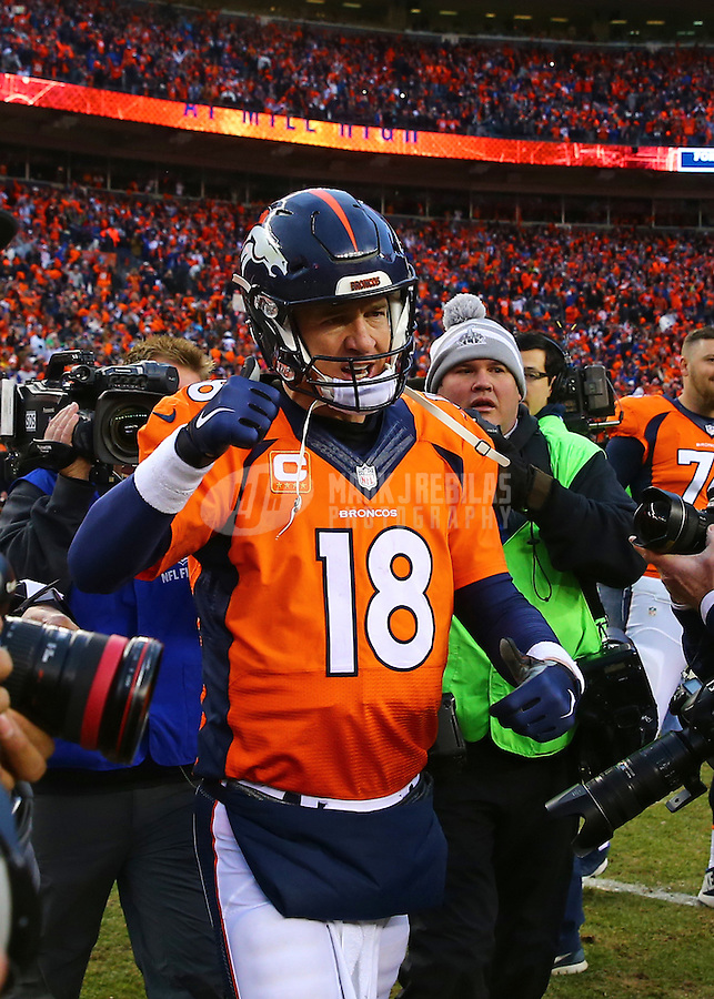 Jan 24, 2016; Denver, CO, USA; Denver Broncos quarterback Peyton Manning (18) reacts following the game against the New England Patriots in the AFC Championship football game at Sports Authority Field at Mile High. The Broncos defeated the Patriots 20-18 to advance to the Super Bowl. Mandatory Credit: Mark J. Rebilas-USA TODAY Sports