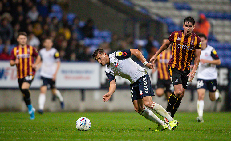 Bolton Wanderers' Dennis Politic breaks<br /> <br /> Photographer Andrew Kearns/CameraSport<br /> <br /> EFL Leasing.com Trophy - Northern Section - Group F - Bolton Wanderers v Bradford City -  Tuesday 3rd September 2019 - University of Bolton Stadium - Bolton<br />  <br /> World Copyright © 2018 CameraSport. All rights reserved. 43 Linden Ave. Countesthorpe. Leicester. England. LE8 5PG - Tel: +44 (0) 116 277 4147 - admin@camerasport.com - www.camerasport.com