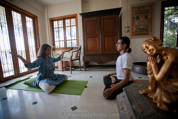 Millie Mitra and her yoga teacher at her home in Benson Town, Bangalore, India. (Millie Mitra is featured in the book What I Eat: Around the World in 80 Diets.) Millie Mitra, a vegan, has a thirst for alternative medicine and homeopathic healing, as well as a deep interest in how her diet affects her body. She has practiced Shivambu (sometimes spelled Sivambu), which is the drinking of one's own first morning urine (200 cc in her practice) as a curative and preventative measure, for over 15 years. Millie applies urine to her skin as well, for the same reasons. Her husband Abhik has tried Shivambu and she helped her children to practice it when they were young, but currently only Millie practices urine therapy.