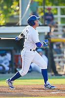 Riley King (31) of the Burlington Royals follows through on his swing against the Princeton Rays at Burlington Athletic Park on July 11, 2014 in Burlington, North Carolina.  The Rays defeated the Royals 5-3.  (Brian Westerholt/Four Seam Images)