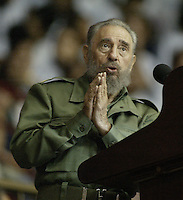 "The Cuban President Fidel Castro, gesture while talk in the graduation act of more of 3000 art instructors, in areas of the ""Ciudad Deportiva"", Friday, October 28, 2005 in Havana, Cuba. Castro criticizes the politics of the European countries and the plans of ""Transition pos - Castro"" presented by political sectors of U.S.  Credit: Jorge Rey/MediaPunch"