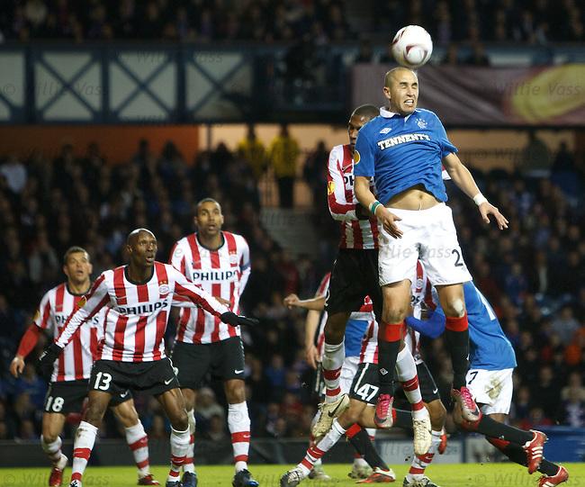 Madjid Bougherra rises to head the ball