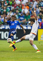 Mexico's forward Eduardo Herrera (20) and United States' midfielder Kyle Beckerman (15) during an international friendly at the Alamodome, Wednesday, April 15, 2015 in San Antonio, Tex. USA defeated Mexico 2-0. (Mo Khursheed/TFV Media via AP Images)