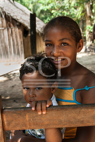 Pakissamba Village (Juruna), Xingu River, Para State, Brazil. A Juruna Indian girl and her brother. The Xingu River, which provides transport and fish for the Juruna, will be reduced to a trickle when the Belo Monte dam is built.