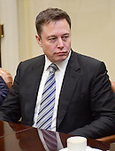 Elon Musk of Space X listens as United States President Donald Trump makes remarks during a breakfast and listening session with key business leaders in the Roosevelt Room of the White House in Washington, DC on Monday, January 23, 2017.<br /> Credit: Ron Sachs / Pool via CNP
