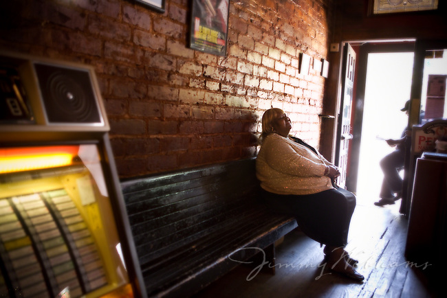 Blues singer Sweet Betty sits on a bench at Blind Willie's, Atlanta.