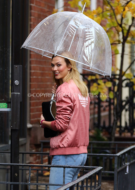 www.acepixs.com<br /> <br /> November 30 2016, New York City<br /> <br /> Model Karlie Kloss braves the rain as she goes out in her West Village neighborhood on November 30 2016 in New York City<br /> <br /> By Line: Zelig Shaul/ACE Pictures<br /> <br /> <br /> ACE Pictures Inc<br /> Tel: 6467670430<br /> Email: info@acepixs.com<br /> www.acepixs.com