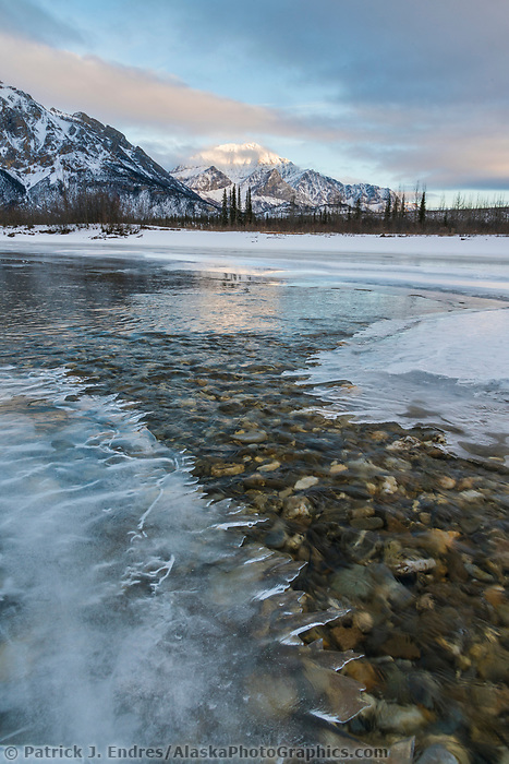 Mt. wiehl and ice forming on the Koyukuk River, Brooks Range, Arctic, Alaska.