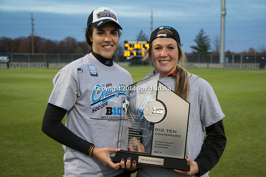 Wisconsin Badgers Genevieve Richard (left) and Caitlyn Clem hold the Big Ten Championship Trophy after an NCAA Big Ten Championship women's soccer game against the Iowa Hawkeyes November 9, 2014, in West Lafayette, Indiana. the Badgers won 1-0 in double overtime. (Photo by David Stluka)