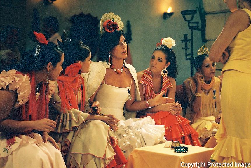 Spanish dancers sitting