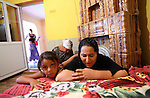 Roma women praying at their home in Barbulesti, Romania. Four families share a house in Barbulesti together with 3 other families since they have been deported from France.