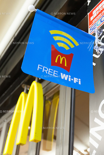 Free wi-fi access promoted outside McDonald's Azabujuban branch on June 23, 2016, Tokyo, Japan. McDonald's Japan launched the service on June 20th and announced that it will provide free wi-fi in some 1,500 branches across Japan by the end of July. (Photo by Rodrigo Reyes Marin/AFLO)