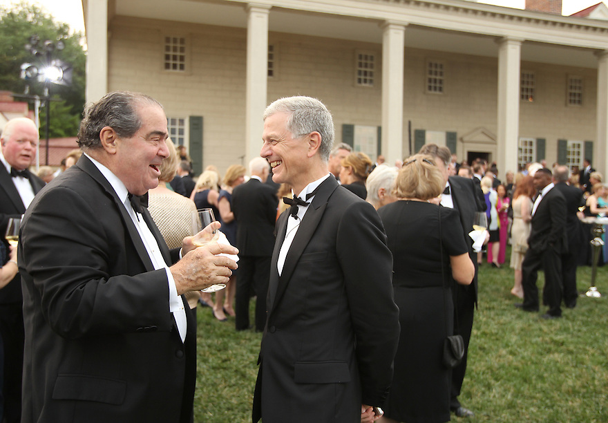 Associate Justice of the Supreme Court Antonin Scalia and Chairman & CEO of Hennessy Bernard Pillion are seen at the Moet Hennessy Celebration of the Hermione Voyage 2015 at George Washington's Mount Vernon on Tuesday, June 9, 2015, in Mount Vernon, Va. (Photo by Donald Traill/Invision for Moet Hennessy/AP Images)