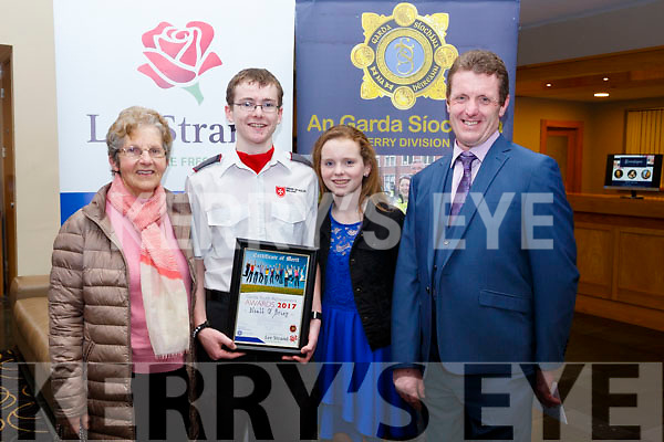 Niall O'Brien of Tralee with his family who received a Special Distinction award at the Kerry Garda Lee Strand Youth Achievements Awards held in the Ballyroe Heights Hotel on Friday night last. L to r, Marie, Niall, Adele and John O'Brien.
