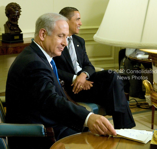 Washington, D.C. - May 18, 2009 -- Prime Minister Benjamin Netanyahu looks over his notes as he awaits the arrival of the press pool during his meeting with United States President Barack Obama in the Oval Office of the White House in Washington, D.C. on Monday, May 18, 2009.  .Credit: Ron Sachs / CNP