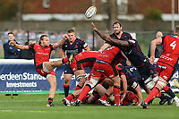 Tjiuee Uanivi of London Scottish (right) tries to block the kick from Braley of Hartpury RFC (left) during the Greene King IPA Championship match between London Scottish Football Club and Hartpury RFC at Richmond Athletic Ground, Richmond, United Kingdom on 28 October 2017. Photo by David Horn.