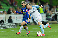 Melbourne, 10 November 2016 - MORTEN NORDSTRAND (19) of the Jets and MICHAEL JAKOBSEN (22) of Melbourne City fight for the ball in the round 6 match of the A-League between Melbourne City and Newcastle Jets at AAMI Park, Melbourne, Australia. Melbourne won 2-1 (Photo Sydney Low / sydlow.com)