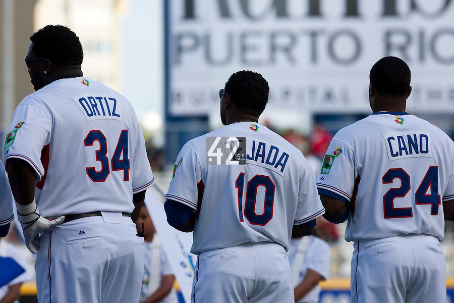 8 March 2009:  #34 David Ortiz, #10 Miguel Tejada and #24 Robinson Cano of Dominican Republic are seen during national anthem prior to a game during the 2009 World Baseball Classic Pool D match at Hiram Bithorn Stadium in San Juan, Puerto Rico. Dominican Republic wins 9-0 over Panama.