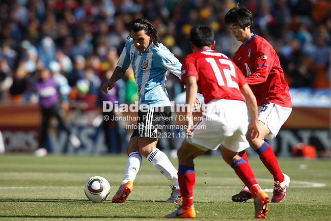 JOHANNESBURG - JUNE 17:  Carlos Tevez of Argentina (11) passes the ball during a  2010 FIFA World Cup soccer match against South Korea June 17, 2010 in Johannesburg, South Africa.  NO mobile use.  Editorial ONLY.  (Photograph by Jonathan P. Larsen)