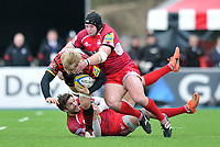 Jackson Wray is double-tackled to ground. Aviva Premiership match, between Saracens and London Welsh on March 3, 2013 at Allianz Park in London, England. Photo by: Patrick Khachfe / Onside Images