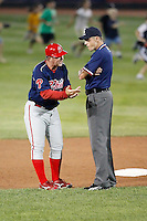 "August 1, 2009:  Manager Steve Roadcap of the Reading Phillies argues a call with umpire Cory Hinga as the ""kids stampede"" through the outfield during a game at Jerry Uht Park in Erie, PA.  Reading is the Eastern League Double-A affiliate of the Philadelphia Phillies.  Photo By Mike Janes/Four Seam Images"