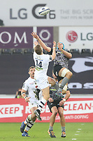 David Strettle of Clermont and Justin Tipuric of Ospreys contend the aerial ball during the Champions Cup Round 1 match between Ospreys and Clermont at The Liberty Stadium, Swansea, Wales, UK. Sunday 15 October 2017
