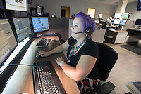 NWA Democrat-Gazette/J.T. WAMPLER Heather Mayfield, public safety dispatcher, works Thursday Sept. 10, 2015 at Benton County Office of Emergency Communications at the Benton County Administration building in Bentonville.