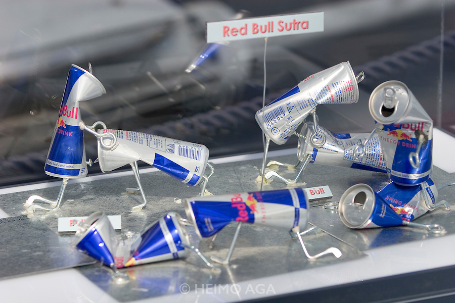 """Hangar-7; the spectacular home of the Flying Bulls (""""Red Bull"""" owner Didi Mateschitz' collection of classic airplanes) next to Salzburg W.A. Mozart airport. Red Bull Can Art Worldwide special exhibition. """"Red Bull Sutra""""."""