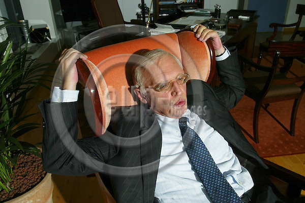 BRUSSELS - BELGIUM - 30 OCTOBER 2006 -- EU Commissioner Günther VERHEUGEN relaxing in his armchair at his office.   PHOTO: ERIK LUNTANG / EUP-IMAGES