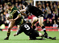 Picture by Shaun Flannery\SWpix.com - 25/11/00 - Rugby League World Cup Final 2000 - Australia v New Zealand, Old Trafford, Manchester, England - Australia's Jason Stevens makes his way through the New Zealand defence.