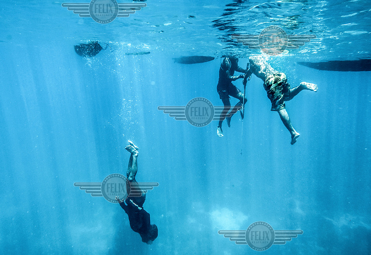 Bajau fishermen swim and hunt for fish and octopus in the Bay of Tomini.