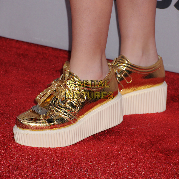 Kathryn Newton.People's Choice Awards 2013 - Arrivals held at Nokia Theatre L.A. Live, Los Angeles, California, USA..January 9th, 2013.detail feet gold sneakers trainers shoes  .CAP/ADM/BP.©Byron Purvis/AdMedia/Capital Pictures.