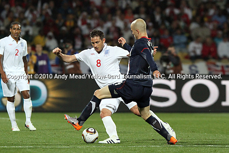 12 JUN 2010:  Michael Bradley (USA)(right) and Frank Lampard (ENG)(8) compete for a loose ball.  The England National Team played the United States National Team played to a 1-1 tie at Royal Bafokeng Stadium in Rustenburg, South Africa in a 2010 FIFA World Cup Group C match.