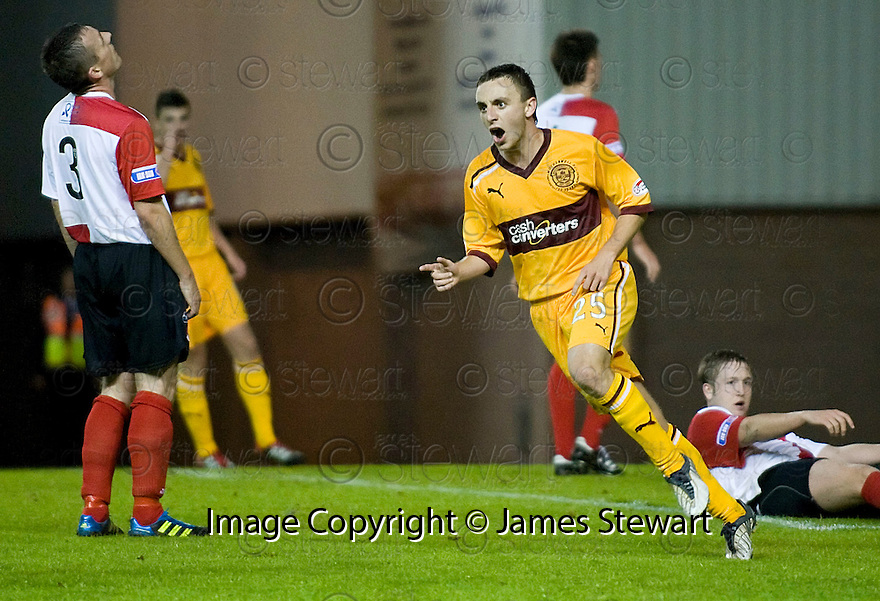 MOTHERWELL'S STEVEN LAWLESS CELEBRATES AFTER HE SCORES MOTHERWELL'S FOURTH GOAL