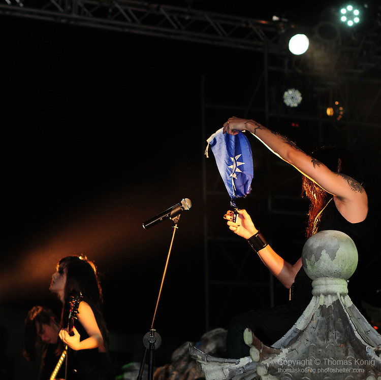 Puli, Taiwan -- Members of the Taiwanese Black Metal band ChthoniC burn the Kuomintang flag during the 'Final Battle at Sing Ling Temple' concert in Puli, Nantou county.<br /> The band is known for their support of Taiwan independence from China.