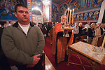 Rev. Stephen Tumbas during the solemn blessing of the five loaves of bread during Christmas Eve Vigil Service, St. Sava Serbian Orthodox Church, Jackson, Calif. The five loaves symbolize the loaves from the wilderness which Christ fed the masses.