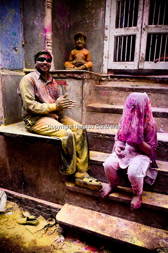 Waves of pilgrims journey every day to Vraja, a farmland described as the place where Lord Krishna (God) participated in the pastime of Holi with the gopis (cowherd girls) thousands of years ago. Believers of this tradition fill the streets of Vrindavan, one of the towns where this Holi pastime took place, reenacting the play of Krishna and the gopis.<br /> Throwing a variety of bright colors, the combined energy of the participants can sometimes result in a rainbow-colored riot. Colors are thrown in both the form of a powder called &quot;gulal&quot; and in the form of water that is colored with the gulal powder. The streets become ecstatic battlefields with colors flying in all directions and people take joy in both attacking and being attacked until their clothing is soaked through and they are caked with gulal from head to toe.<br /> Spanning of 16 days during the festive season of Holi, the Hindu spring festival of colors is celebrated in every village of Vraja, with different villages having their largest celebration on different days. This means that pilgrims can and do make a tour of the villages to see the entire array of festivities. Tens of thousands of faithful people, chanting and praying in an overcrowded parade, make their way to all of the principal temples of Vraja.<br /> The religious fervor of the believers makes a complete spectacle. Ecstasies that invade their bodies, filling every corner, provoke them to dance madly, smile, and cry. They then turn around to face the unending waves of people coming in and out of the temple and raising their voices in loud chanting. After everyone has retired for the evening, the soiled and colorful streets bear witness to the end to this festival which celebrates the cheerful Indian spirit.