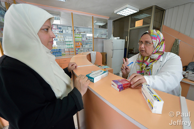 Pharmacist Raghda Hijaz assists a patient in the Al Ahli Arab Hospital in Gaza City. The Anglican institution is a member of the ACT Alliance.<br /> <br /> The 2014 war provoked serious damage to Gaza's health infrastructure. Seventeen hospitals, 56 primary health care facilities and 45 ambulances were damaged or destroyed. Sixteen health care workers were killed and 83, most of them ambulance drivers and volunteers, were injured.