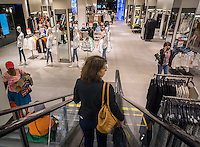 Shoppers in a Zara store on Fifth Avenue in New York on Thursday, July 9, 2015.  The chain is owned by Spanish retail giant Inditex, one of the largest clothing retailers in the world. (© Richard B. Levine)