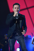MIAMI, FL - NOVEMBER 07: Fonseca performs during the iHeartRadio Fiesta Latina concert at American Airlines Arena on November 7, 2015 in Miami, Florida. Credit Larry Marano © 2015
