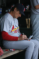 SAN FRANCISCO - APRIL 13:  Manager Tony La Russa of the St. Louis Cardinals writes on his pine up card in the dugout during the game against the San Francisco Giants at AT&T Park in San Francisco, California on April 13, 2008.  The Giants defeated the Cardinals 7-4.  Photo by Brad Mangin