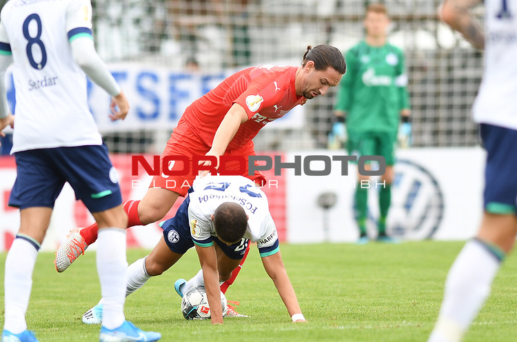 10.08.2019,  GER; DFB Pokal, SV Drochtersen/Assel vs FC Schalke 04 ,DFL REGULATIONS PROHIBIT ANY USE OF PHOTOGRAPHS AS IMAGE SEQUENCES AND/OR QUASI-VIDEO, im Bild Marcel Adrijanic (Drochtersen #08) versucht sich gegen Amine Harit (Schalke #25) durchzusetzen Foto © nordphoto / Witke *** Local Caption ***