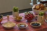 St Walstans Day, Bawburgh, Norfolk 2018. Village Hall, members of the community gather for a Ploughmans lunch and home made cakes after the procession to St Walstans healing holy well.